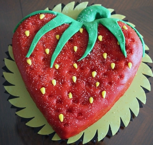 Strawberry cake! :D A heart shaped cake pan was used. Strawberry red marzipan and other bits to match. :D